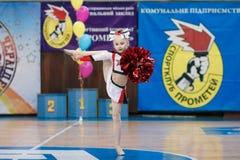 Young cheerleaders perform at the city cheerleading championship. Kamenskoye, Ukraine - March 8, 2017: Championship of the city of Kamenskoye in cheerleading Royalty Free Stock Image