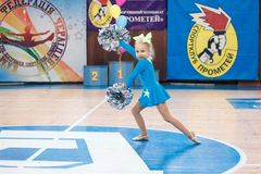 Young cheerleaders perform at the city cheerleading championship. Kamenskoye, Ukraine - March 8, 2017: Championship of the city of Kamenskoye in cheerleading Royalty Free Stock Photography