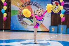Young cheerleaders perform at the city cheerleading championship. Kamenskoye, Ukraine - March 8, 2017: Championship of the city of Kamenskoye in cheerleading Royalty Free Stock Images