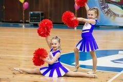 Young cheerleaders perform at the city cheerleading championship. Kamenskoye, Ukraine - March 8, 2017: Championship of the city of Kamenskoye in cheerleading Stock Photos