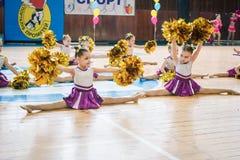 Young cheerleaders perform at the city cheerleading championship. Kamenskoye, Ukraine - March 9, 2017: Championship of the city of Kamenskoye in cheerleading Stock Photography