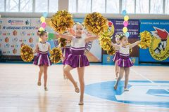 Young cheerleaders perform at the city cheerleading championship. Kamenskoye, Ukraine - March 9, 2017: Championship of the city of Kamenskoye in cheerleading Stock Photos