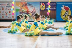 Young cheerleaders perform at the city cheerleading championship. Kamenskoye, Ukraine - March 9, 2017: Championship of the city of Kamenskoye in cheerleading Royalty Free Stock Photography