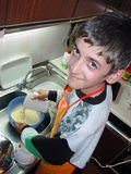 Young chef. Preparing mixture for pancake Royalty Free Stock Photos
