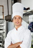 Young Chef With Arms Crossed In Kitchen Royalty Free Stock Image