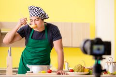 The young chef blogger explaining food preparation. Young chef blogger explaining food preparation royalty free stock images