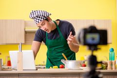 The young chef blogger explaining food preparation stock images