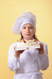 Young chef with cake Stock Image