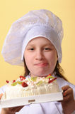 Young chef with cake Royalty Free Stock Photo