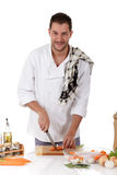 Young chef caucasian, tenderloin piece preparati Royalty Free Stock Photo