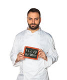 Young chef with chalkboard. Royalty Free Stock Images