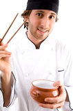 Young chef with chopsticks and bowl Royalty Free Stock Images