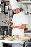 Young Chef With Clipboard At Kitchen Stock Image