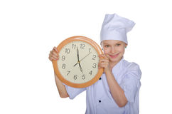 Young chef with clock Royalty Free Stock Image