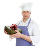 Young chef cook holding present box. Royalty Free Stock Photo