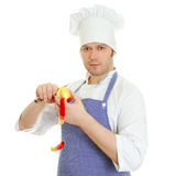 Young chef cook pealing apple. Isolated on white Royalty Free Stock Photography