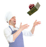 Young chef cook throwing present box. Stock Images