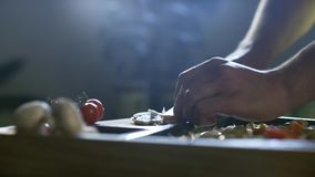 Young chef cut mushrooms on table for pizza 4K. Young chef cut mushrooms on table for pizza in kitchen 4K stock video footage