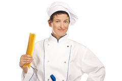 Young chef with fan of spaghetti Stock Image