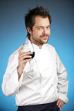 Young chef with glass of wine Stock Photography