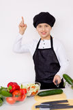 Young chef going to prepare a salad isolated Stock Image