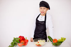 Young chef going to prepare a salad isolated Stock Photo