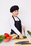 Young chef going to prepare a salad isolated Royalty Free Stock Images