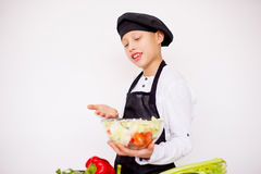Young chef going to prepare a salad isolated Royalty Free Stock Photography