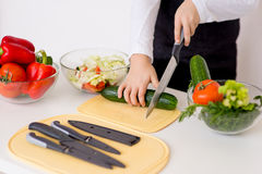 Young chef going to prepare a salad no face isolated Royalty Free Stock Image