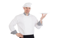 Young chef holding empty plate Stock Photography