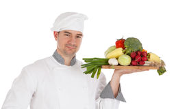 Young chef holding fresh vegetable Stock Images