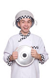 Young chef holding pan isolated on white Stock Photo