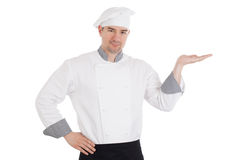 Young chef holding something on hand Stock Photo