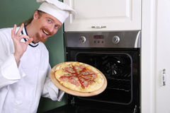 Young chef with italian pizza Royalty Free Stock Images