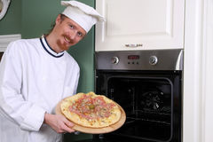 Young chef with italian pizza Stock Images