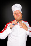 Young chef joking with knife Royalty Free Stock Photos