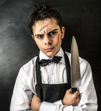Young chef with knife. And scars Stock Image