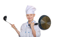 Young chef with a ladle and pan Royalty Free Stock Photos