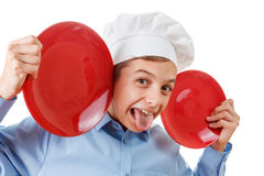Young chef like a monkey grimassy, humor, chef's hat. Isolated studio Stock Photo