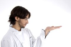 Young chef looking his palm Royalty Free Stock Photo