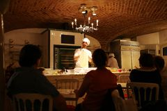 Young chef makes an apple strudel show in Vienna, Austria Royalty Free Stock Images