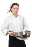 Young chef mixing with whisk Stock Images