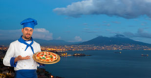 Young chef with neapolitan pizza margherita. With Gulf of Naples in background Stock Images