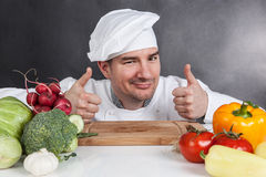 Young chef with OK sign and vegetable Royalty Free Stock Photo