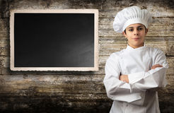 Young chef with panel for menu Royalty Free Stock Photos
