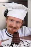 Young chef with piece of cake Royalty Free Stock Photo