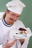 Young chef with piece of cake Stock Photo