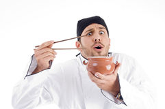 Young chef posing with bowl and chopstick Stock Images