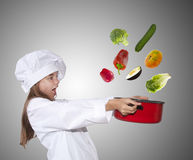 Young chef with pot. Caucasian blond girl with cook costume Royalty Free Stock Images