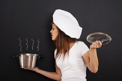 Young chef with pot Royalty Free Stock Image